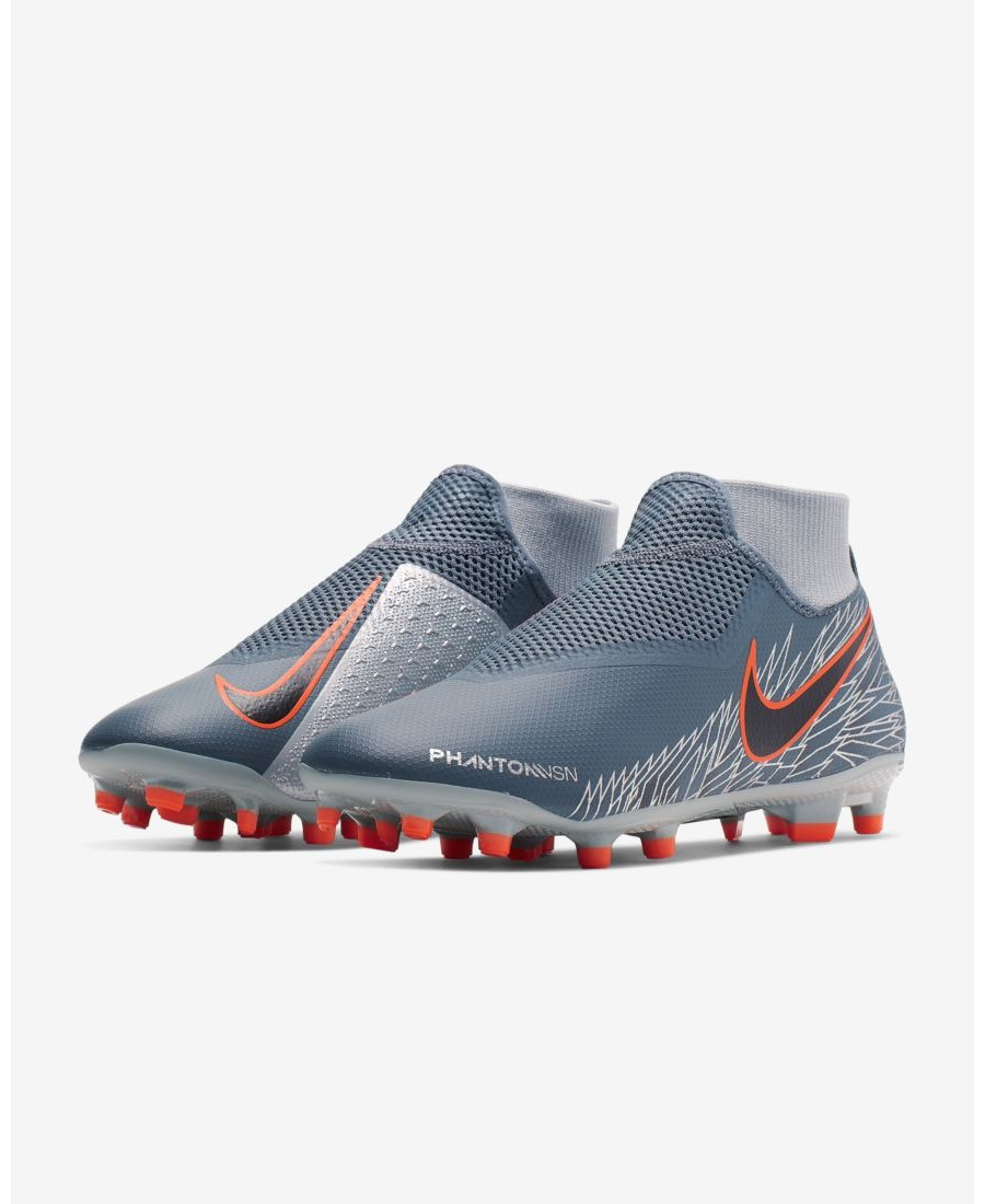bd8c255e9 The Nike Phantom Vision Academy Dynamic Fit MG brings the fierce precision  of street play to the pitch. A foot-hugging sleeve has a custom feel and  the ...